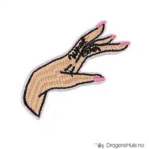 Bilde av Stoffmerke: En kvinnes hånd